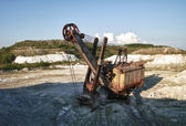 Abandoned old rusty excavator in quarry — Stock Photo