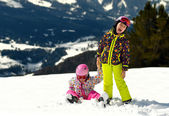 Two little girls playing on the snow. — Stock Photo