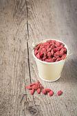 Goji berries in wooden background — Stock Photo