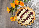 Cherry pie on the wooden table — Stock Photo