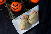 Halloween treat sausage in the dough — Stock Photo