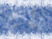 Blue winter background with snowflakes — Stock Photo