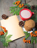 Christmas card with cup of cocoa, fir tree, pinecones and rowan — Stock Photo