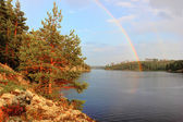 Rainbow on lake Ladoga, Karelia, Russia — Stockfoto