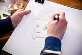 Hands draw caricature — Stock Photo