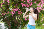 Woman drinking water — Stock Photo
