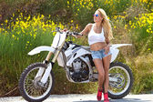 Young woman with motorcycle — Foto Stock