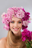 Woman with floral wreath — Stock Photo