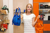 Holding two handbags — Stock Photo