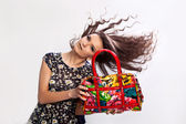 Woman holding a bag — Stock Photo