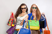 Women with bags and smiling — Stock Photo