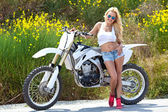 Young woman with motorcycle — Stock Photo