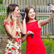 Girls making selfie and eating grapes — Stock Photo #51610293