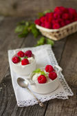Dessert from cottage cheese and raspberries on a white napkin  — Stock Photo