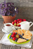 Morning tea with waffles, milk and fresh berries — Stock Photo