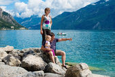 Family admires the view of the mountains in lake garda,Italy — Stock Photo