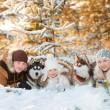 Laughing family and husky dog in winter park — Stock Photo #49926179