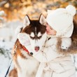 Beautiful little girl in winter forest with dog — Stock Photo #49926221
