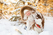 Beautiful little girl in winter forest with dog — Stock Photo