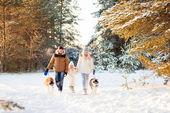 Happy family and husky dog in winter park — Stock Photo