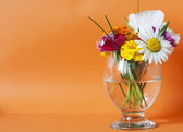 Flowers in a glass — Stock Photo