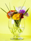 Flowers in a glass yellow — Stock Photo