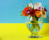Flowers in a glass flag — Stock Photo