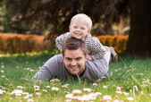Happy young father with little son outdoors — Photo