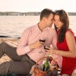 Happy young couple enjoying picnic on the beach and have good time on summer vacations — Stock Photo #47372447