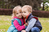 Portrait of two happy young kids playing at the park — Photo