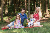 Happy family are walking in the green summer park. picnic — Stock Photo