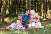 Happy family are walking in the green summer park. picnic — Foto Stock