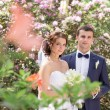 Bride and Groom at wedding Day walking Outdoors on spring nature. Bridal couple, Happy Newlywed woman and man embracing in green park. Loving wedding couple outdoor. — Stock Photo #47389335