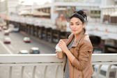 Beautiful happy girl drinking a cup of coffee - outdoor portrait — 图库照片