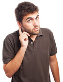 Young man trying to listen something — Stock Photo