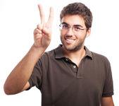 Man doing victory symbol — Stock Photo