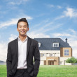 Handsome young asian man in front of his house — Stock Photo #47345895