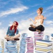 Students sitting on books — Stock Photo
