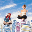 Students sitting on books — Stock Photo #47345961