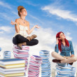 Students sitting on books — Stock Photo #47345969