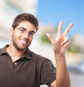 Young man counting with fingers — Stock Photo