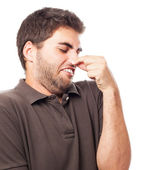 Young man smelling — Stock Photo