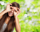 Woman doing glasses gesture — Stock Photo