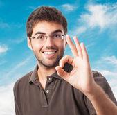 Man doing success symbol — Stock Photo