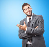 Businessman doing welcome gesture — Stock Photo