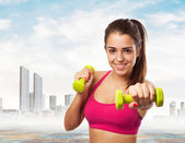 Girl exercising with weights — Stock Photo