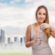 Woman opening bottle of water — Stock Photo