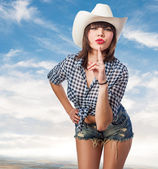 Pretty young cowgirl — Stock Photo