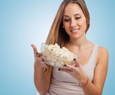 Woman holding popcorn — Stock Photo