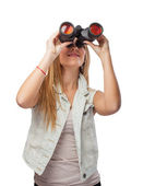 Woman looking through binoculars — Stok fotoğraf